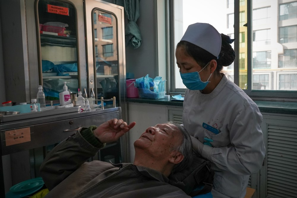 A nurse prepares a patient for surgery at Xi'an No.1 Hospital